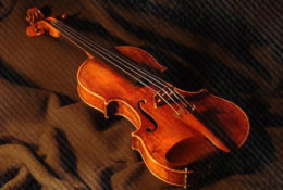 violin on red fabric